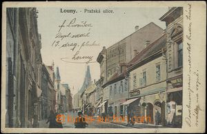 61101 - 1906 Louny - Prague street, shops, people; Us, bumped corner